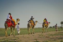 Tourists enjoy the camel ride at Sam Desert, Jaisalmer, Rajasthan, India Royalty Free Stock Photos