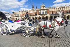 Tourists enjoy a carriage ride at the Market Square in Krakow Royalty Free Stock Image