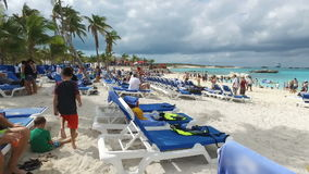 Tourists enjoy on deckchairs and under the awning,Bahamas stock video