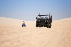 Tourists enjoy on the desert by jeep car in mui ne Stock Image