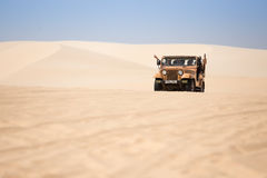 Tourists enjoy on the desert by jeep car in mui ne Stock Photo