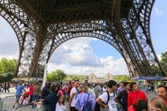 Tourists enjoy at Eiffel Tower - Paris Stock Photography
