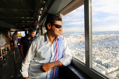 Tourists enjoy at Eiffel Tower - Paris Stock Images