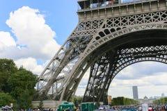 Tourists enjoy at Eiffel Tower - Paris Stock Image