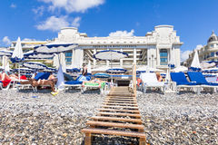 Tourists enjoy the good weather at the beach in Nice, France Royalty Free Stock Photo