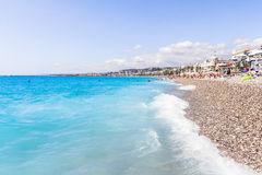 Tourists enjoy the good weather at the beach in Nice, France Stock Photos