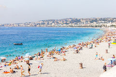 Tourists enjoy the good weather at the beach in Nice, France Stock Image
