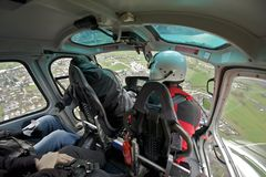 Tourists enjoy helicopter sightseeing trip in Bernese Oberland, Switzerland. Royalty Free Stock Image
