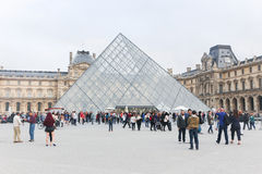 Tourists enjoy at Louvre museum , Paris Royalty Free Stock Image