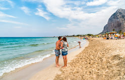 Tourists enjoy mediterranean sea in famous San Vito Lo Capo beach, Italy. San Vito Lo Capo, Trapani, Italy - September 29, 2016: Tourists enjoy mediterranean sea Stock Photo