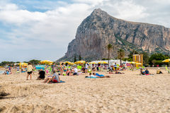 Tourists enjoy mediterranean sea in famous San Vito Lo Capo beach, Italy Stock Images