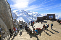 Tourists enjoy Panoramic view on  Chamonix terrace Royalty Free Stock Photography