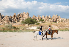 Tourists enjoy ride horses in Cappadocia royalty free stock photos