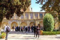 Tourists enjoy sightseeing around the Golestan palace. stock images