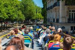 Tourists enjoy sightseeing tour on a bus Stock Image