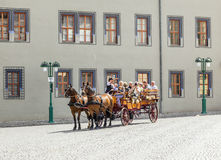 Tourists enjoy a sightseeing tour in Erfurt via horse and carriage Stock Photos