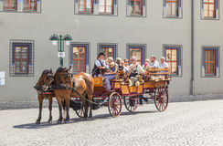 Tourists enjoy a sightseeing tour in Erfurt via horse and carriage Stock Photography