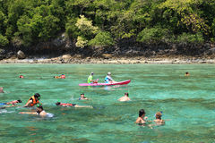 Tourists enjoy with snorkeling in a tropical sea at Phi Phi isla Stock Images