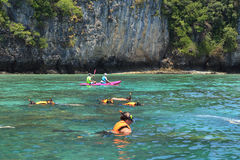 Tourists enjoy with snorkeling in a tropical sea at Phi Phi isla. Krabi,Thailand-March 16,2015:Tourists enjoy with snorkeling in a tropical sea at Phi Phi island Stock Photography