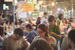 Tourists enjoy the street food at the night market in Chinatown, Royalty Free Stock Image