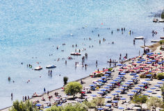 Tourists enjoy sun and watersports in the volcano lake of Castel Gandolfo. Rome - Italy Stock Photography