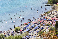Tourists enjoy sun and watersports in the volcano lake of Castel Gandolfo. Rome - Italy Stock Photos