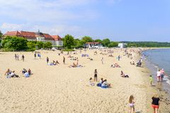 Sopot beach. Tourists enjoy the sunny weather and relaxing on the Baltic sea beach on 26 May 2018 in Sopot, Poland Stock Image