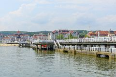 Sopot pier. Tourists enjoy the sunny weather and walking along the pier on 26 May 2018 in Sopot, Poland royalty free stock photography