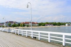Sopot pier. Tourists enjoy the sunny weather and walking along the pier on 26 May 2018 in Sopot, Poland royalty free stock photos