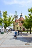 Sopot street. Tourists enjoy the sunny weather and walking in front of the balneological clinic with a lighthouse on 26 May 2018 in Sopot, Poland. The building stock photography