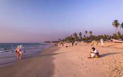 Tourists enjoy sunsets at kolava beach goa Stock Image