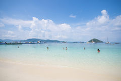 Tourists enjoy swimming at the coral island Royalty Free Stock Photo