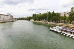 Tourists enjoy at Trip on the Seine river. Paris - France Royalty Free Stock Photos