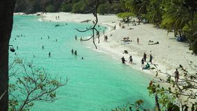 Small torpical island with white sandy beach. stock footage