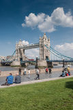 Tourists enjoy a view of Tower Bridge. LONDON, UK - MAY 12, 2016: Tourists enjoy a view of Tower Bridge on a sunny Spring day Stock Photo