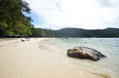 Tourists enjoy white sand beach of Sapi island in Sabah Stock Photography