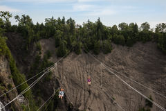Tourists enjoying an adventure in a zipline at Montmorency Falls stock images