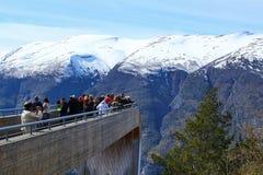 Tourists enjoying the amazing scenary of fjord on the Stegastein viewpoint stock photo