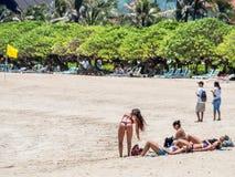 Tourists enjoying the beach in Nusa Dua Bali stock photo
