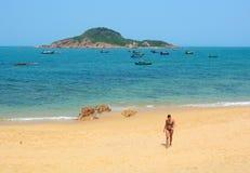 Tourists enjoying on beautiful beach Stock Image