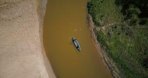 Tourists enjoying kayaking on small river turn. Two men paddling boat. Top view aerial drone 4k. Peaceful quiet retreat. Tourists enjoying beautiful kayaking stock footage