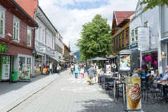 Tourists enjoying the beautiful weather walking through the streets of Lillehammer on June 27, 2016 in Lillehammer, Norway Stock Images