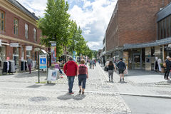 Tourists enjoying the beautiful weather walking through the streets of Lillehammer on June 27, 2016 in Lillehammer, Norway Royalty Free Stock Images