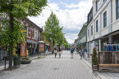 Tourists enjoying the beautiful weather walking through the streets of Lillehammer on June 27, 2016 in Lillehammer, Norway Stock Image