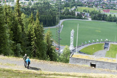Tourists enjoying the beautiful weather watch from above the Olympic ski jump on June 27, 2016 in Lillehammer, Norway. Lillehammer City Winter Olympics in 1994 Stock Images