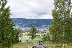 Tourists enjoying the beautiful weather watch from above the Olympic ski jump on June 27, 2016 in Lillehammer, Norway. Lillehammer City Winter Olympics in 1994 Stock Image