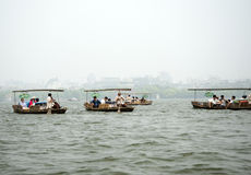 Tourists enjoying a boat ride at the West Lake, Hangzhou Royalty Free Stock Image