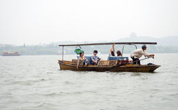 Tourists enjoying a boat ride at the West Lake, Hangzhou Royalty Free Stock Photos