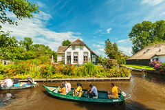 Tourists enjoying a canal cruise with small boats in the famous Royalty Free Stock Image