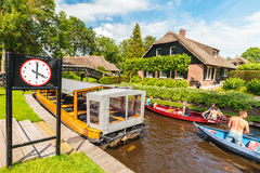 Tourists enjoying a canal cruise with small boats in the famous Royalty Free Stock Images
